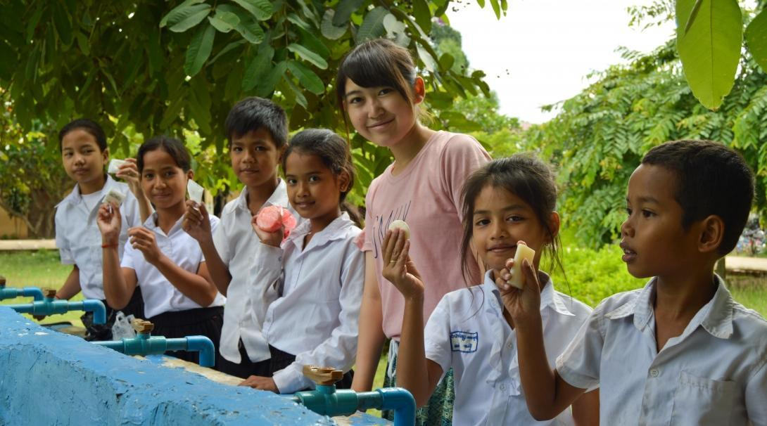 Childcare work in Cambodia for volunteers on a group trip includes ensuring that children practice good hygiene everyday.